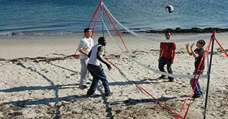 Students playing beach volleyball