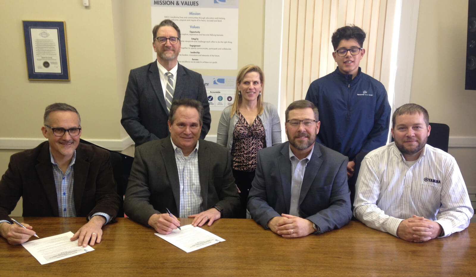 Front row (from left) are Dan Belyea, Maine Community College System Executive Director of Workforce Training; Steve Arnold, owner of Yarmouth Boat Yard and ...